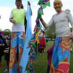 Aria stilt walking with a friend